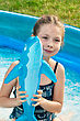 Smiling girl in the swimming pool stock photo