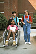 Girl in Wheelchair with Friends stock image