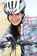 Checkered Girl On Bike With Safety Helmet stock image