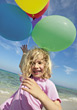 Girl on the Beach with Balloons stock photo