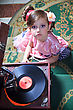 Girl In Pink With A Gramophone. Shooting From The Top stock photography