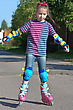 girl riding on roller blades on summer holidays stock photo