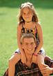 Girl Sitting on Brother's Shoulders stock photo