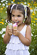 Girl With Two Portion Of Ice Cream With Satisfied Little Face stock photo