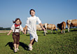 Girls Holding Hands Running On Cattle Ranch stock photography