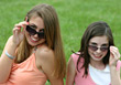 Laughing Girls with Sunglasses Close-up stock photo