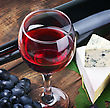 Glass Of Red Wine With Bottle And Grape stock photography