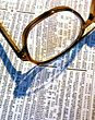 Glasses on Newspaper stock image