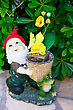 Gnome And Frog With Yellow Flowers. stock image