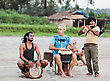GOA, INDIA - NOVEMBER 08: Hippies Playing Music On Arambol Beach On November, 08, 2011, Goa, India. At The Arambol Beach People Often Sit And Enjoy The Setting Sun, Playing Music, Meditation, Etc stock image