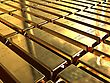 Gold ingots stacked in neat rows.