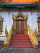 Golden Dragons In Front Of Carved Doors Of Asian Temple, Wat Chiang Man, Chiang Mai, Northern Thailand stock image