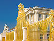 Political Golden Gate And Palace Facade In Versailles Over Blue Sky. France stock photo
