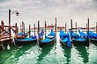 Gondolas Floating In The Grand Canal On A Cloudy Day stock photography