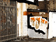 Graffiti Wall & Iron Gate stock photography