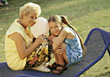 Grandmother and Granddaughter Outdoors stock photo