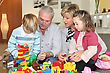 Grandparents And Grandchildren Playing stock photography