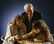 Grandparents Playing Board Game stock photo