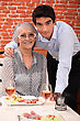 People Eating  Grandson And Grandmother In Restaurant stock photo