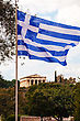 Greek Flag And Temple Of Hephaestus In Athens, Greece On A Sunny Day stock photo