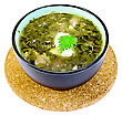 Green Nettle Soup In A Bowl On A Stand Cork Isolated On White Background stock photography