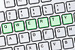Green Qwerty Buttons On Silver Computer Keyboard stock photo
