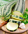 Green Striped Zucchini, Garlic, Parsley, Napkin, Knife On A Wooden Board stock image