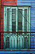 Green Wood Venetian Blind And A Red Blue Metal Wall In La Boca Buenos Aires Argentina stock image