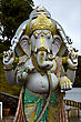 Grey Marble Statue Of A Hinduism Elephant Shiva Vishnu Brahma In A Temple Near A Lake In Mauritius Africa stock photography