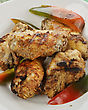 Snack Grilled Chicken Wings With Sweet Pepper stock photo