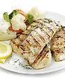 Grilled Fish Fillet With Vegetables And Lemon stock image