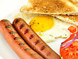 Grilled Polish Sausages With Egg And Vegetables stock photo