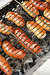 Sausages Grilled Sausages On Grill, With Smoke Above It stock image