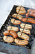 Picnic Grilled Sausages On Grill, With Smoke Above It stock image