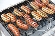 Cookout Grilled Sausages On Grill, With Smoke Above It stock image