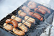 Cookout Grilled Sausages On Grill, With Smoke Above It stock photo