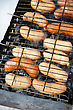 Grilled Sausages On Grill, With Smoke Above It stock photo