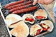 Grilled Sausages,halloumi Cheese With Tomatoes In Pita Bread.
