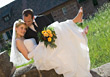 Wedding Groom Carrying Bride After Wedding stock image