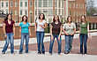 Group of College Girls Jumping stock photography