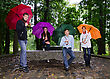 Group Of Friends Under Colourful Umbrellas stock image