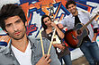 Performance Group Of Musicians Busking On The Streets stock photo