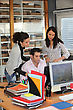Group Of Office Workers Looking At A Computer