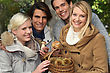 Group Of Young People With A Basket Of Chestnuts And Mushrooms stock image