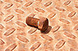 Grungy Background With A Rusty Ridged Metal Plate And Old Hexagonal Bolt