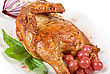 Half Roasted Chicken Closeup With Grape And Greens On A White