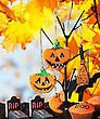 Halloween Cookies Hanging On A Tree On A Background Of Autumn. Focus On The Center Pumpkin Cookies stock photo