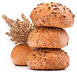 Hamburger Bun Or Roll And Wheat Ears Bunch Isolated On White Background Cutout stock photo
