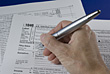 Hand Completing Tax Form 1040 stock photography