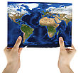 Hand Holding A World Paper Map Isolated On A White stock photography